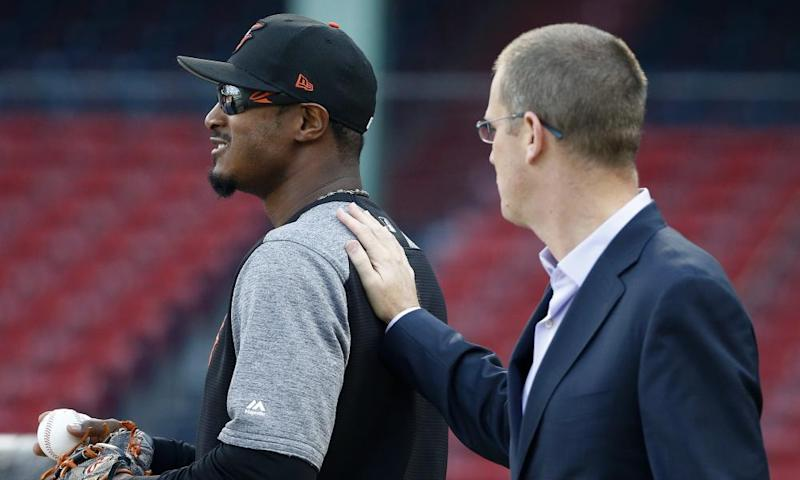 Boston Red Sox President Sam Kennedy apologizes to the Baltimore Orioles' Adam Jones before Tuesday's game.