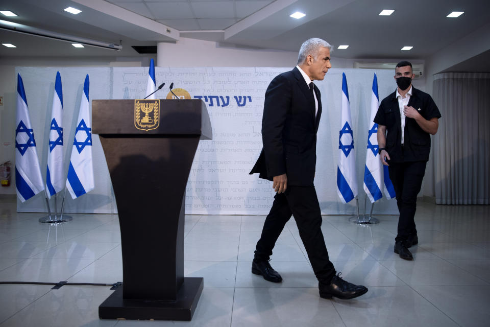 """REPLACES COMMON GOOD INSTEAD OF COMMON GROUND - Israeli opposition leader Yair Lapid, leaves the podium at the end of a news conference in Tel Aviv, Thursday, May. 6, 2021. Lapid called on his potential partners to find """"common good"""" and expressed optimism that a new coalition government would be formed. (AP Photo/Oded Balilty)"""
