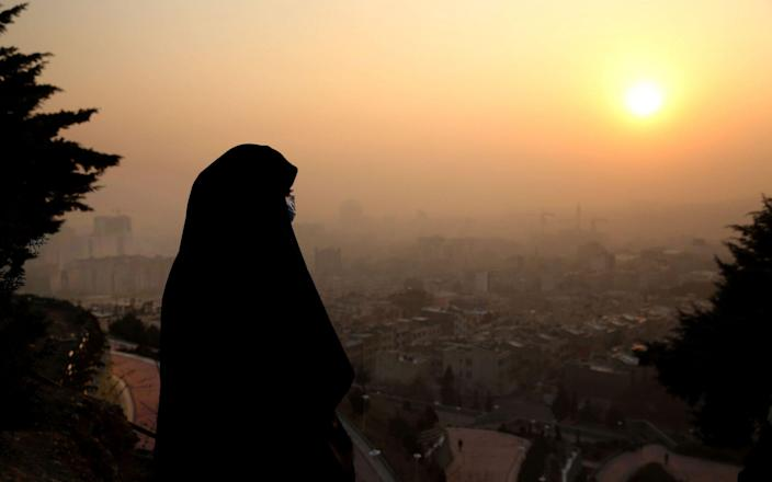 Iran has ordered the closure of illegal Bitcoin operations, as energy shortages have contributed to air pollution - ATTA KENARE/AFP