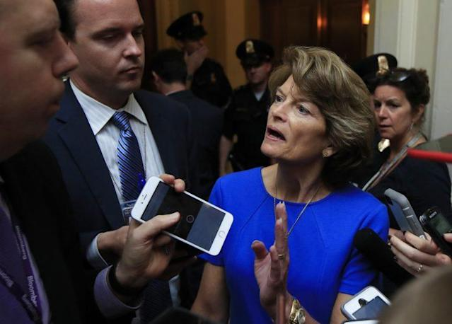 Sen. Lisa Murkowski, R-Alaska, is surrounded by reporters as she walks toward the Senate floor on Capitol Hill in Washington, Tuesday, July 18, 2017. (Photo: Manuel Balce Ceneta/AP)