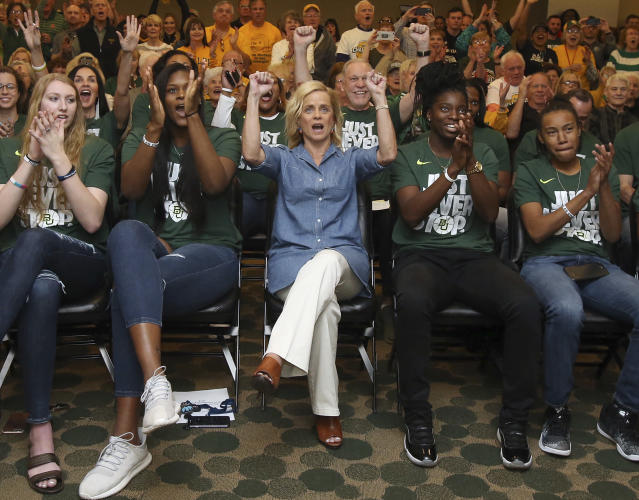 Baylor head coach Kim Mulkey, center, and players react after they hear their seeding during an NCAA college basketball selection show Monday, March 12, 2018, in Waco, Texas. (Jerry Larson/Waco Tribune-Herald via AP)