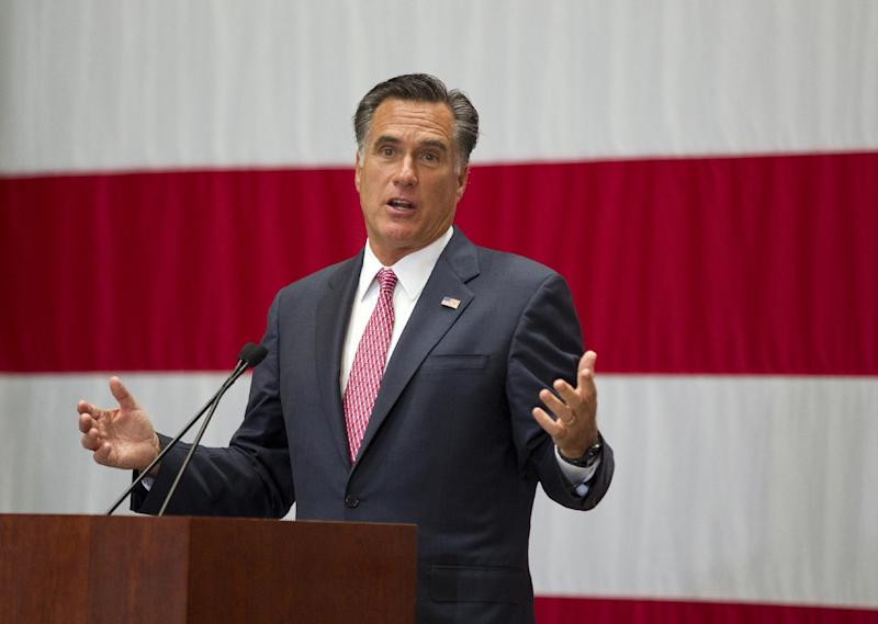 Republican presidential candidate, former Massachusetts Gov. Mitt Romney gestures during a campaign stop at USAA insurance company, Wednesday, June 6, 2012, in San Antonio, Texas. (AP Photo/Evan Vucci)