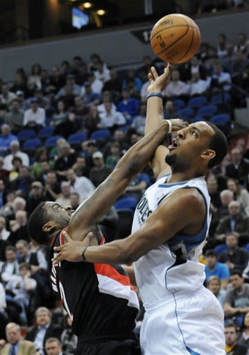 Portland Trail Blazers' Gerald Wallace, left, breaks up a scoring attempt by Minnesota Timberwolves' Derrick Williams during the first half of an NBA basketball game on Wednesday, March 7, 2012, in Minneapolis. (AP Photo/Jim Mone)