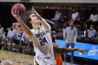 Baylor guard Matthew Mayer (24) shoots in front of Oklahoma State forward Matthew-Alexander Moncrieffe, right, in the first half of an NCAA college basketball game Saturday, Jan. 23, 2021, in Stillwater, Okla. (AP Photo/Sue Ogrocki)