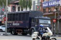 An immigration truck carrying Myanmar migrants to be deported from Malaysia is seen in Lumut