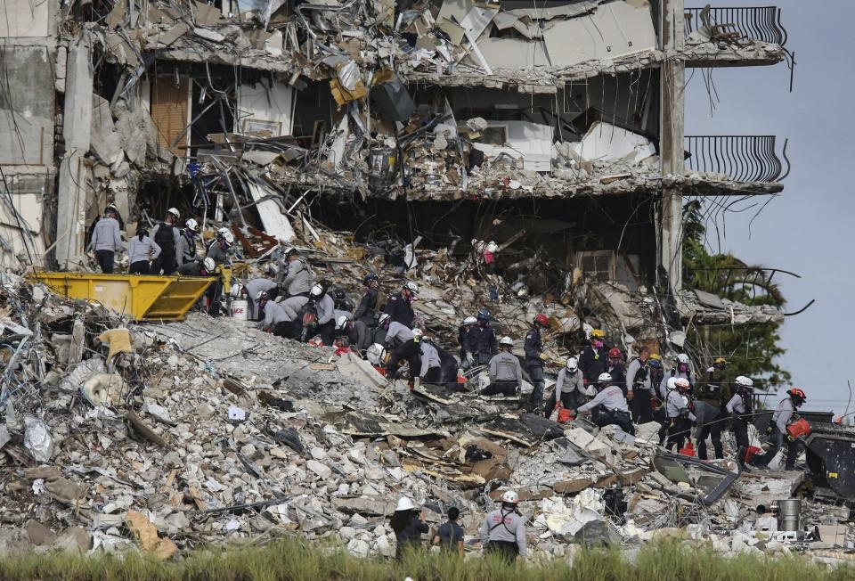 Search and rescue teams look for survivors at the Champlain Towers South residential condo, Tuesday, June 29, 2021, in Surfside, Fla. Many people were still unaccounted for after Thursday's fatal collapse. (Al Diaz /Miami Herald via AP)