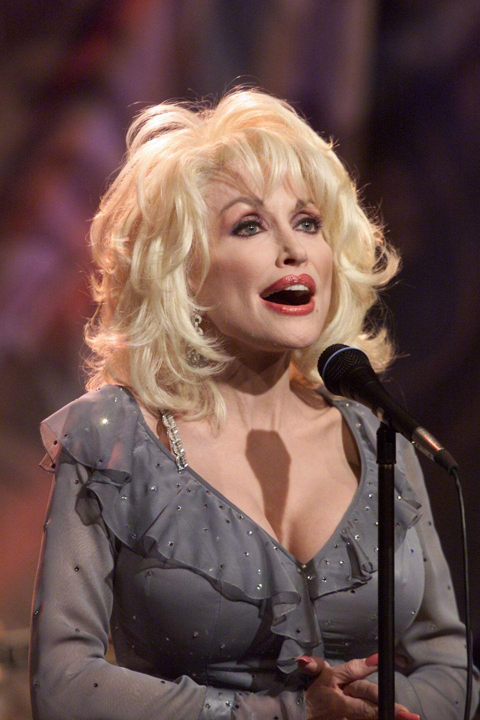 <p>Parton performs at the<em> Tonight Show With Jay Leno</em> in a rare, understated gray. </p>