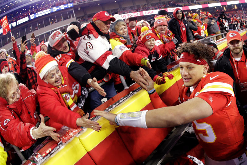 Chiefs fans celebrate a playoff win with Kansas City Chiefs quarterback Patrick Mahomes. (AP Photo/Charlie Riedel)