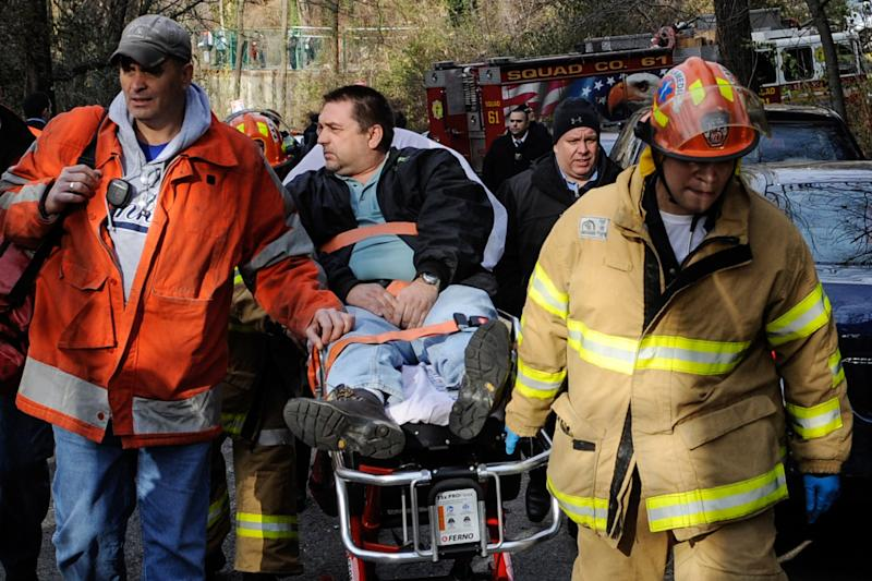 "FILE - In this Dec. 1, 2013 photo, Metro North Railroad engineer William Rockefeller is wheeled on a stretcher away from the area where the commuter train he was operating derailed in the Bronx borough of New York. Federal investigators say Rockefeller, who was engineer on a New York commuter train that derailed last year, killing four people, has a serious sleep disorder. A medical document made available Monday April 7, 2014, by the National Transportation Safety Board says he has ""severe obstructive sleep apnea."" The NTSB did not say whether the engineer's disorder contributed to the crash.(AP Photo/Robert Stolarik, File)"