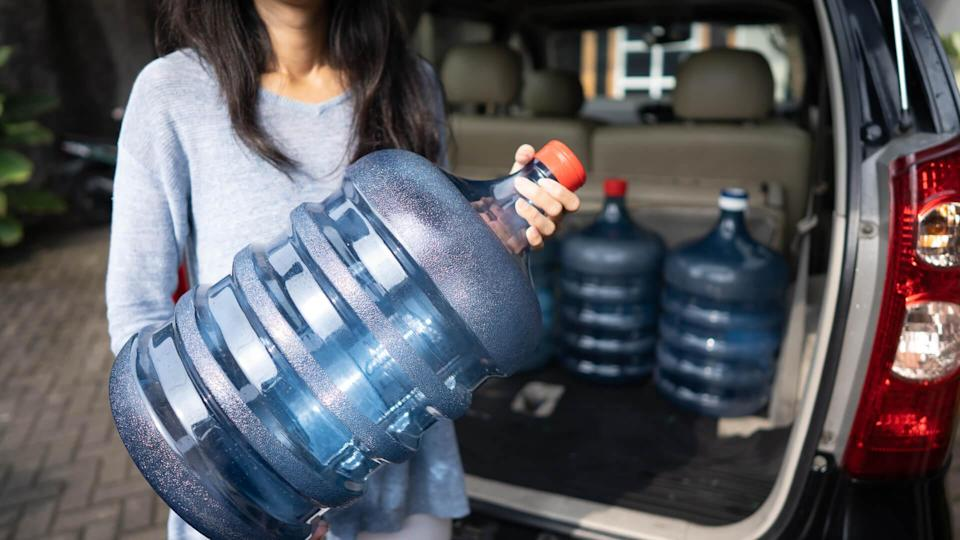 woman with water jugs for emergency