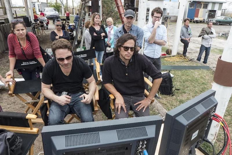 "This undated image released by HBO shows writer and executive producer Nic Pizzolatto, left, and director Cary Fukunaga on the set of ""True Detective,"" a series new premiering premiering Jan. 12, at 9 p.m. EST. (AP Photo/HBO, Jim Bridges)"