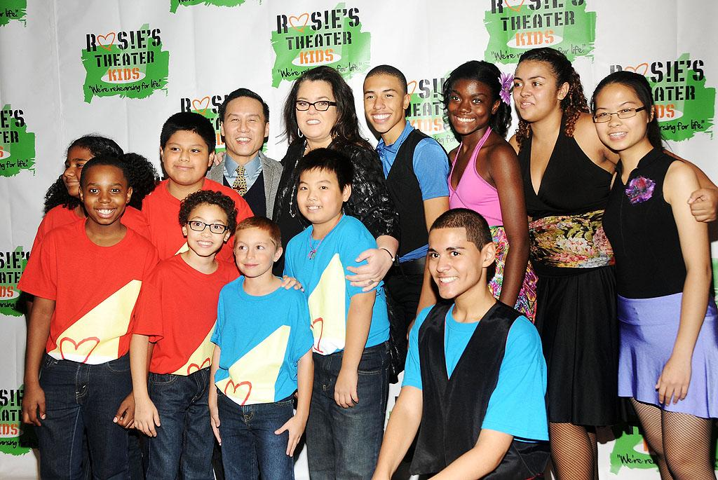 NEW YORK, NY - OCTOBER 15:  (C) Actress/Comedian Rosie O'Donnell and (L) B.D. Wong pose for photos with Rosie's Theater Kids at the 2012 Building Dreams For Kids Gala at The New York Marriott Marquis on October 15, 2012 in New York City.  (Photo by Desiree Navarro/WireImage)