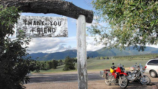 PHOTO: In this file photo taken on July 9, 2009, the Bob Marshall Wilderness cuts a jagged line across the horizon as patrons leave Trixi's Antler Saloon in Ovando, Montana. (Eliza Wiley/AP, File)