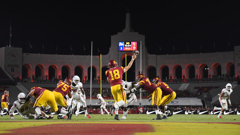 Southern California quarterback JT Daniels, center, passes during the first half of an NCAA college football game against Fresno State Saturday, Aug. 31, 2019, in Los Angeles. (AP Photo/Mark J. Terrill)