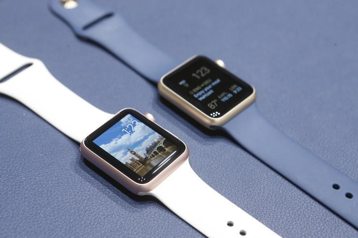 Apple Watches in new colors are displayed during an Apple media event in San Francisco