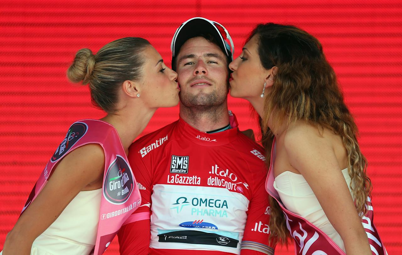 FORIO, ITALY - MAY 05:  Mark Cavendish of Great Britain and Omega Pharma - Quick-Step retained his Maglia Rossa (Points Jersey) after stage two of the Giro d'Italia 2013, a Team Time Trial from Ischia to Forio, on May 5, 2013 in Forio, Italy.  (Photo by Bryn Lennon/Getty Images)