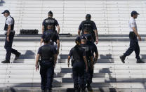 Members of the police are seen in front of the entrance to the Palais des Festival prior to the 74th international film festival, Cannes, southern France, July 5, 2021. The Cannes film festival runs from July 6 - July 17. (AP Photo/ Brynn Anderson)