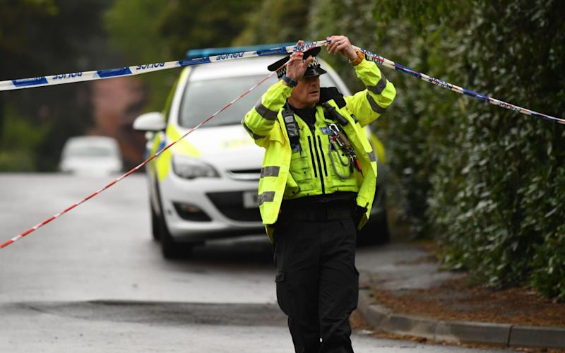 A police cordon remains in place in the quiet Dorset village of St Ives, near Ringwood - Credit: RUSSELL SACH