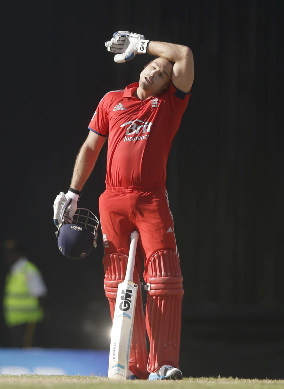 England's Michael Lumb wipes his head after he scored a century with Joe Root during their first one-day international cricket match against West Indies at the Sir Vivian Richards Cricket Ground in St. John's, Antigua, Friday, Feb. 28, 2014. (AP Photo/Ricardo Mazalan)