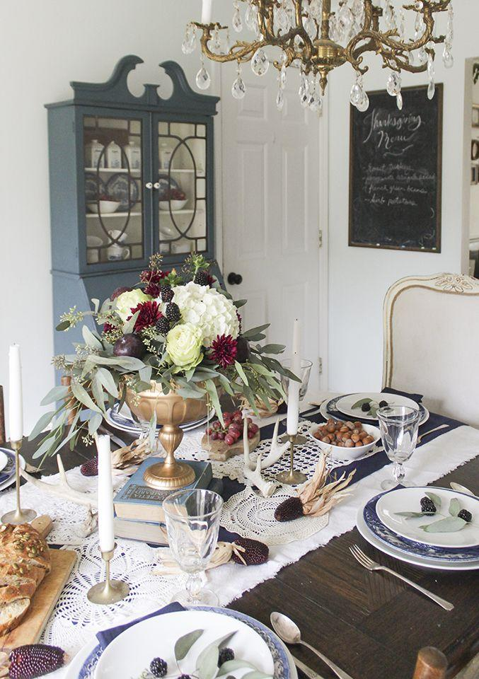 "<p>Grab some old books around your house to create this simple, yet elegant centerpiece. </p><p><strong>Get the tutorial at <a rel=""nofollow"" href=""http://www.shadesofblueinteriors.com/thanksgiving-tablescape-in-navy-burgundy-and-gold/"">Shades of Blue Interiors. </a></strong></p>"