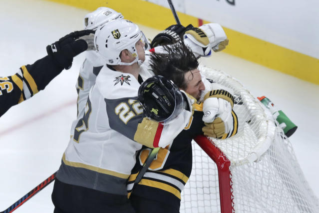 Boston Bruins left wing Brad Marchand is slammed into the goal by Vegas Golden Knights defenseman Nick Holden (22) during the third period of an NHL hockey game in Boston, Tuesday, Jan. 21, 2020. (AP Photo/Charles Krupa)