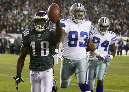 Philadelphia Eagles wide receiver Maclin scores a touchdown in front of the Dallas Cowboys Spencer and Ware in Philadelphia