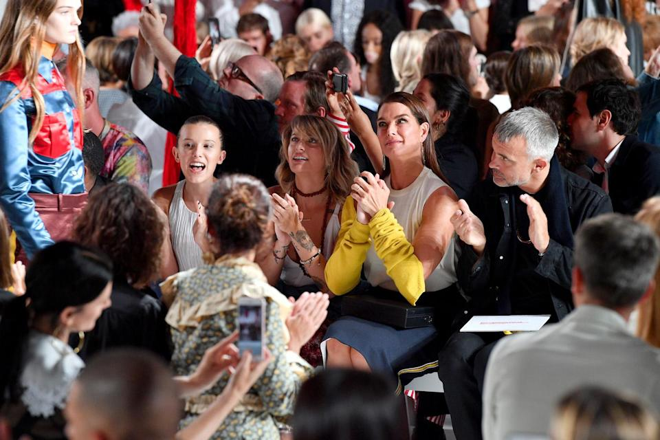 Millie Bobby Brown watches the Calvin Klein SS18 show alongside Paris Jackson and Brooke Shields [Photo: Getty]