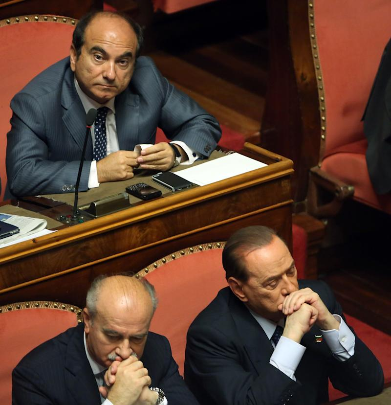 ROME, ITALY - OCTOBER 02: Domenico Scilipoti of PDL (upper left) and former Prime Minister Silvio Berlusconi attend the confidence vote for Enrico Letta's government at the Italian Senate, Palazzo Madama on October 2, 2013 in Rome, Italy. After asking all his ministers to resign, Silvio Berlusconi changed his mind and voted in support of the government as Prime Minister Enrico Letta gained the confidence vote at the Italian Senate with 235 consents out of 321 seats. (Photo by Franco Origlia/Getty Images) (Photo: Franco Origlia via Getty Images)