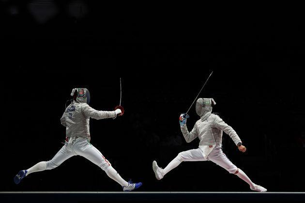 CHIBA, JAPAN - JULY 28: Aldo Montano of Team Italy (L) competes against Junghwan Kim of Team South Korea (R) during the Men's Sabre Team Gold Medal Match on day five of the Tokyo 2020 Olympic Games at Makuhari Messe Hall on July 28, 2021 in Chiba, Japan. (Photo by Patrick Smith/Getty Images) (Photo: Patrick Smith via Getty Images)