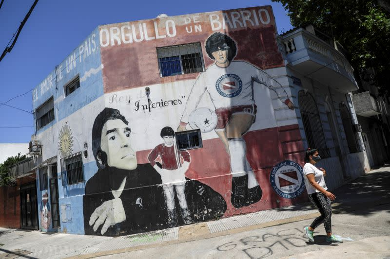 FILE PHOTO: People mourn the death of soccer legend Diego Armando Maradona, in Buenos Aires