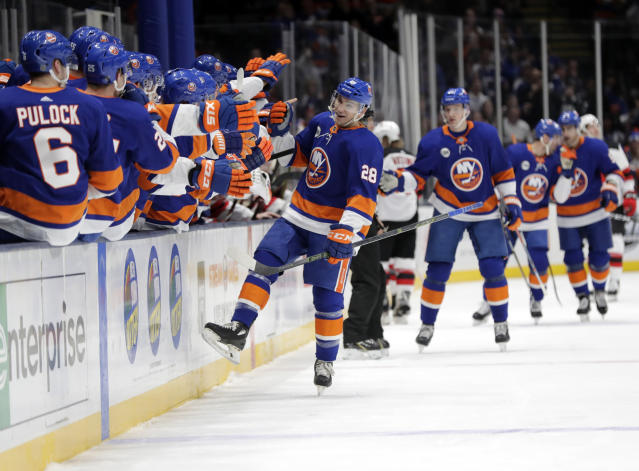 New York Islanders' Michael Dal Colle (28) celebrates with teammates after scoring a goal during the first period of an NHL hockey game against the New Jersey Devils, Thursday, Jan. 17, 2019, in Uniondale, N.Y. (AP Photo/Frank Franklin II)