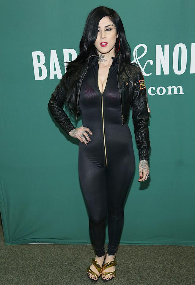 Tattoo artist-turned-reality TV star Kat Von D turned heads upon arriving at a book singing in New York in a see-through, skin-tight jumpsuit that featured a suggestively placed zipper. In addition to a visible pink bra, Von D paired the body-con ensemble with red hoop earrings, metallic sandals, and a cropped leather jacket. For once, Kat's innumerable tats weren't the ghastliest part of her getup. (4/15/2013)