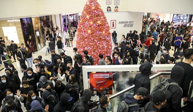 Anti-government protesters hold a 'Christmas shopping' rally in Harbour City. Photo: Winson Wong