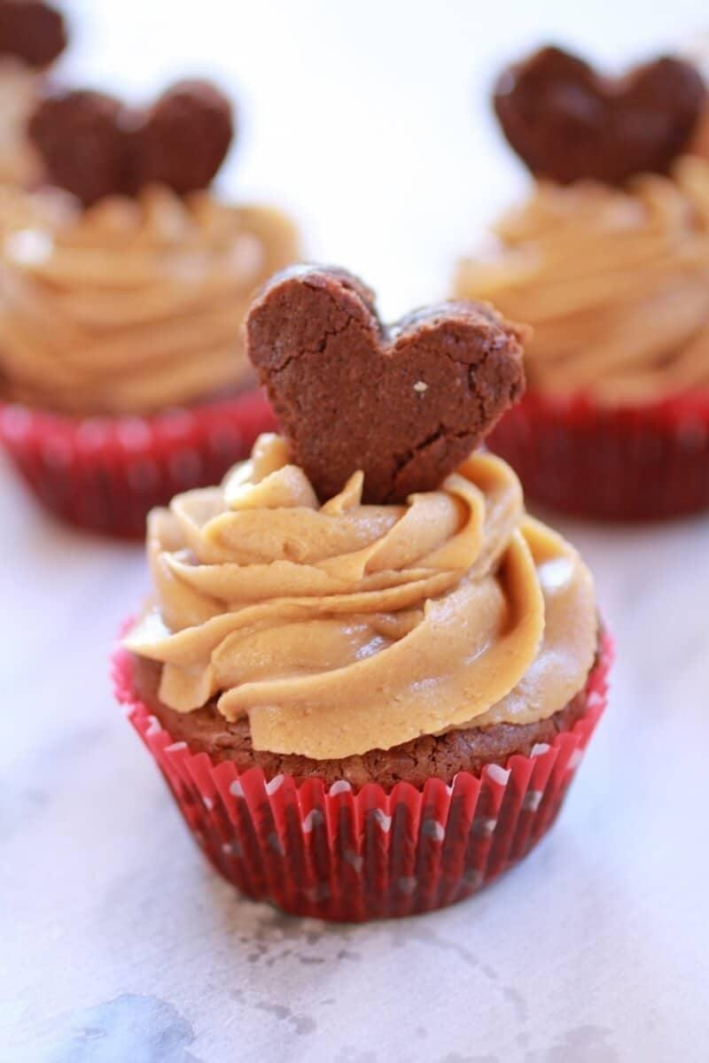 "<p>Imagine: rich fudge brownie cupcakes topped with a creamy peanut butter frosting. Yup. These are so good, they'll practically melt in your mouth, so be sure to have napkins nearby! Since this recipe yields 12 cupcakes, feel free to divide the ingredient list in half if you're only baking for two.</p> <p><strong>Get the recipe:</strong> <a href=""https://www.halfbakedharvest.com/gooey-brownie-cupcakes-with-peanut-butter-frosting/"" class=""link rapid-noclick-resp"" rel=""nofollow noopener"" target=""_blank"" data-ylk=""slk:valentine brownie cupcakes with peanut butter frosting"">valentine brownie cupcakes with peanut butter frosting</a></p>"