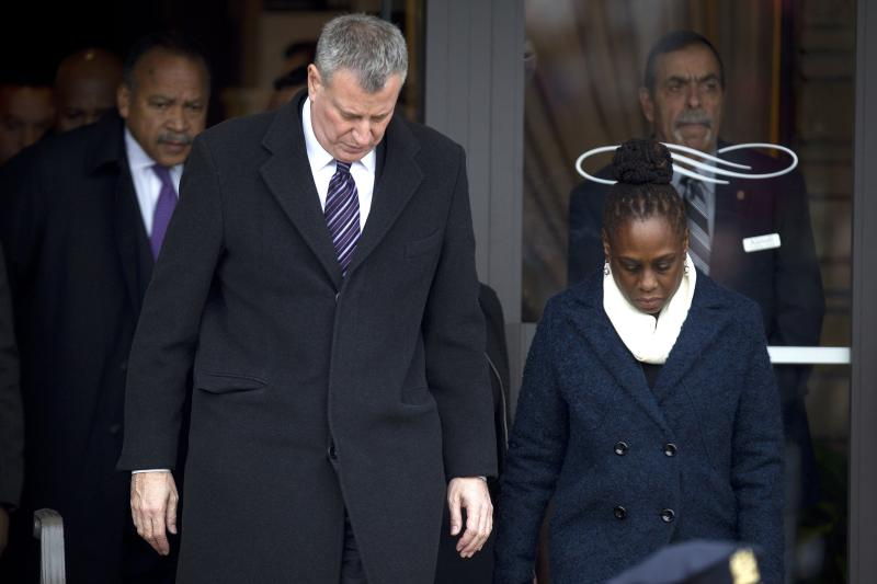 New York Mayor Bill de Blasio and wife Chirlane McCray leave following the funeral of slain New York Police Department officer Wenjian Liu in the Brooklyn borough of New York