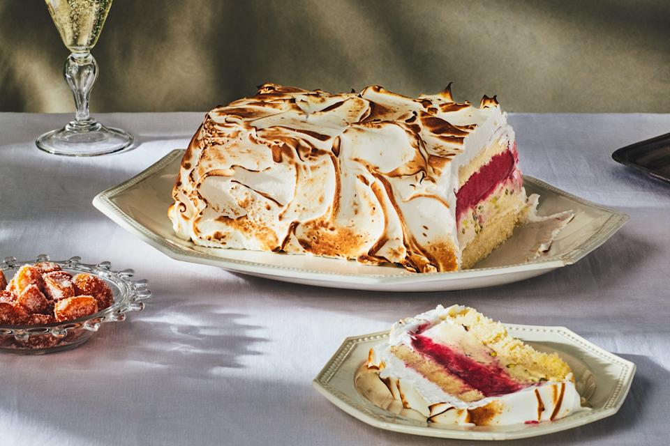 "<p>The magic of Christmas can be summed up in this splendid present to everyone at the table. Underneath the toasted meringue, you'll find a surprising lightness that comes from cheery red cranberry sorbet layered with pale green pistachio ice cream and buttery pound cake (store-bought works just fine). Gift wrapping is optional.</p> <p><em>This recipe was developed for</em> Gourmet <em>magazine's December 2009 issue. Unfortunately,</em> Gourmet <em>was shuttered before that issue was published. So in 2018, we dug up the entire Christmas menu and posted it <a href=""https://www.epicurious.com/holidays-events/lost-christmas-recipes-of-gourmet-magazine-article?mbid=synd_yahoo_rss"" rel=""nofollow noopener"" target=""_blank"" data-ylk=""slk:here"" class=""link rapid-noclick-resp"">here</a>.</em></p> <a href=""https://www.epicurious.com/recipes/food/views/cranberry-pistachio-baked-alaska?mbid=synd_yahoo_rss"" rel=""nofollow noopener"" target=""_blank"" data-ylk=""slk:See recipe."" class=""link rapid-noclick-resp"">See recipe.</a>"