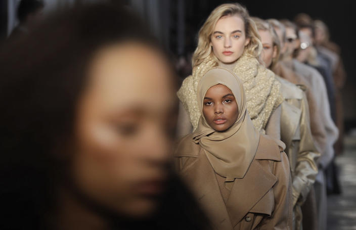 FILE - In this Feb. 23, 2017 file photo, Somali-American model Halima Aden wears a creation part of the Max Mara women's Fall-Winter 2017-18 collection, that was presented in Milan, Italy. Somali-American model Halima Aden has announced that she is taking a step back from the fashion industry, saying that the pandemic slowdown has given her time to see instances when her desire to maintain a hijab was not properly respected. (AP Photo/Luca Bruno).