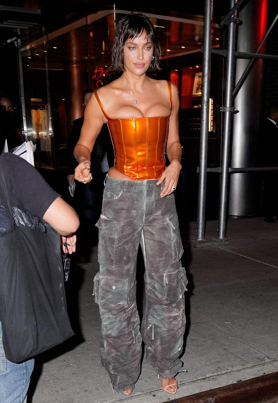 <p><strong>8 September</strong></p><p>Irina Shayk paired a statement orange corset with utility trousers.</p>
