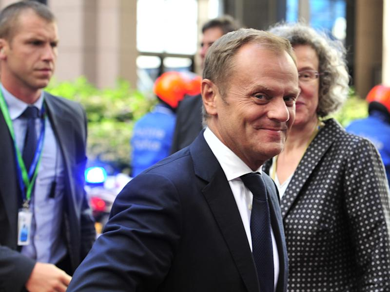 Polish Prime Minister Donald Tusk arrives in Brussels on July 16, 2014 for a special meeting of the European Council (AFP Photo/Georges Gobet)
