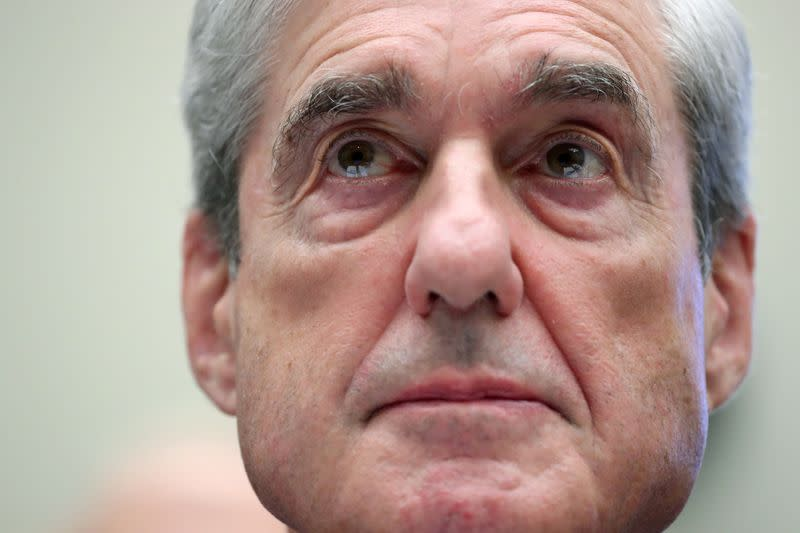 FILE PHOTO: Former Special Counsel Robert Mueller testifies before House Judiciary Committee hearing on the Mueller Report on Capitol Hill in Washington
