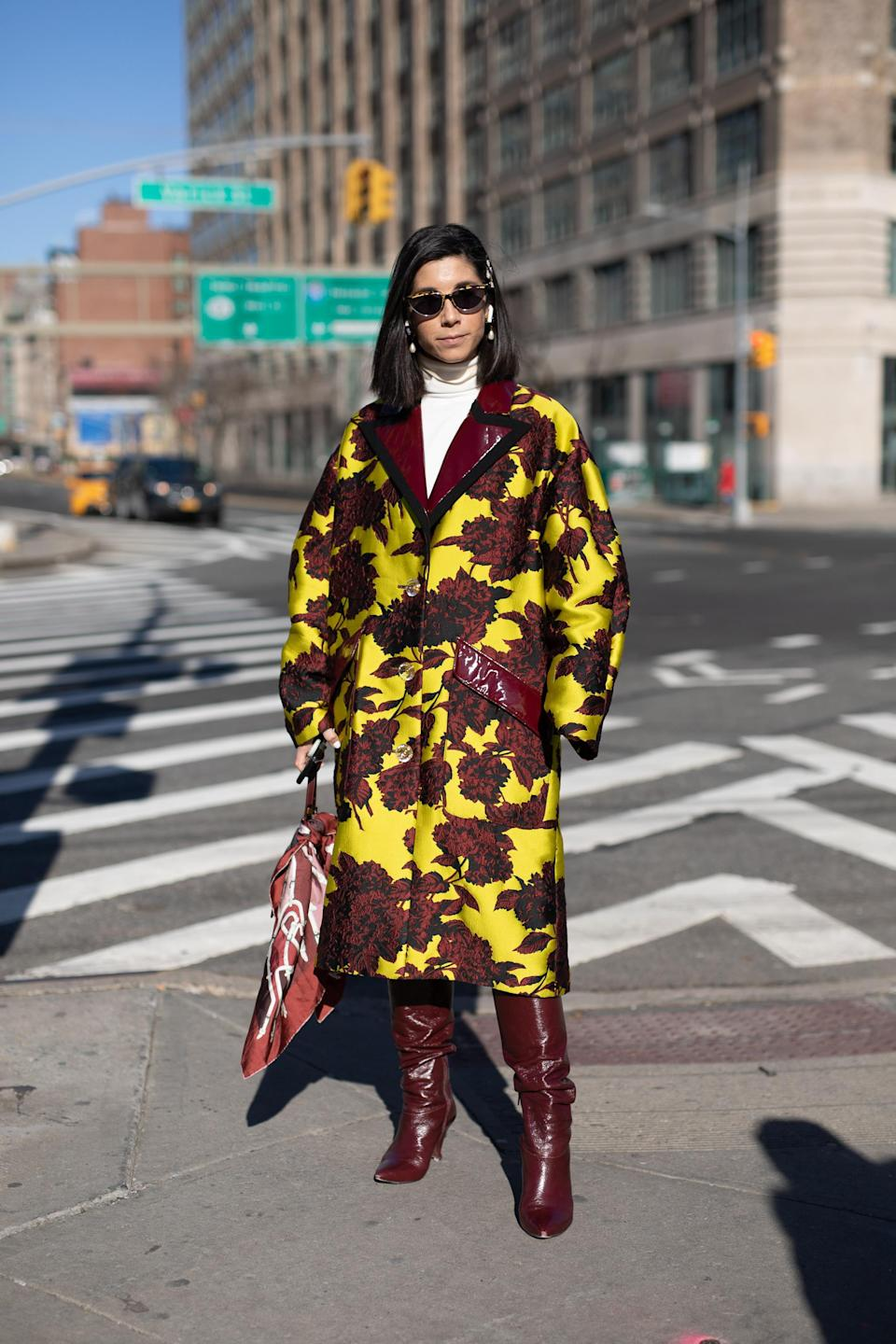 <p>A guest poses during New York Fashion Week. <em>[Photo: Getty]</em> </p>