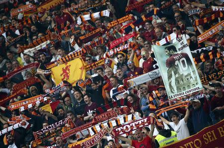 Football Soccer - AS Roma v Lazio - Italian Serie A - Olympic Stadium, Rome, Italy - 30/04/17 AS Roma's supporters hold scarfs before the match. REUTERS/Alessandro Bianchi