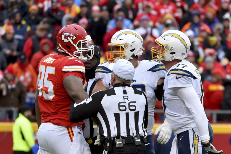 Kansas City Chiefs defensive tackle Chris Jones (95) and Los Angeles Chargers quarterback Philip Rivers (17) argue during the first half of an NFL football game in Kansas City, Mo., Sunday, Dec. 29, 2019. (AP Photo/Ed Zurga)