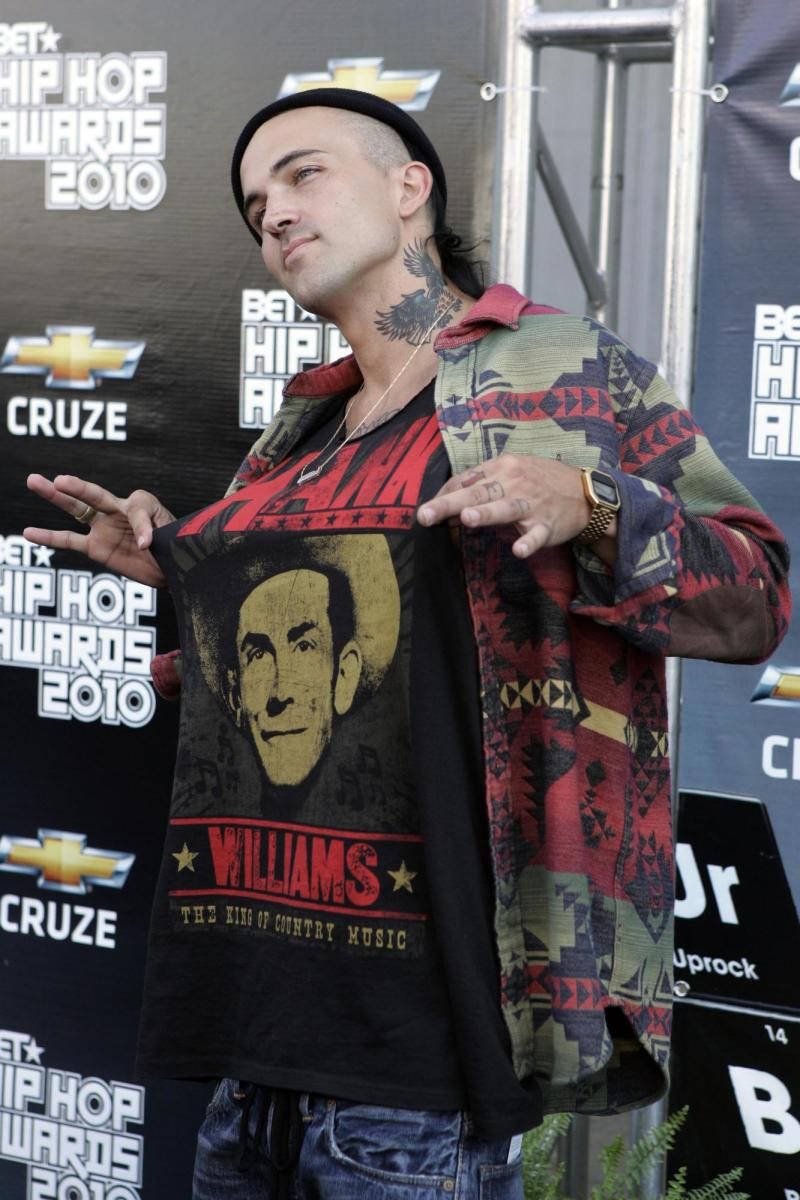 Yellow Wolf shows off his Hank Williams shirt as he arrives on the red carpet for the BET Hip Hop Awards Saturday Oct. 2, 2010, in Atlanta. (AP Photo/John Amis)