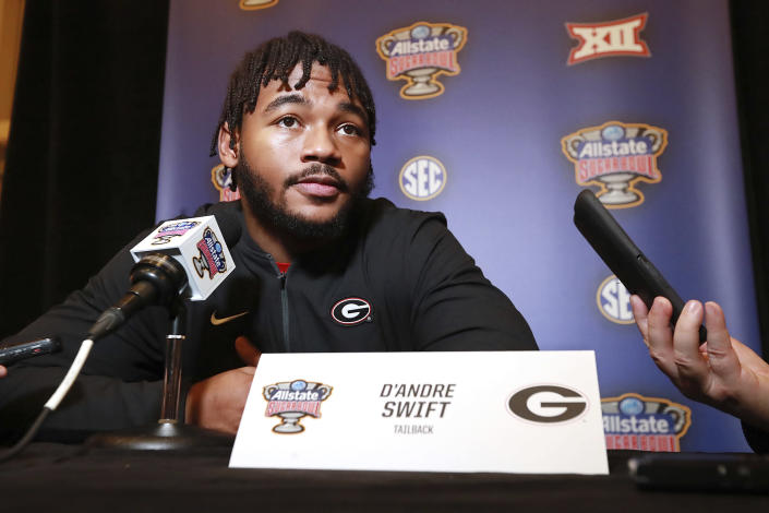 Georgia tailback D'Andre Swift, who has been injured and may or may not play in the game, takes questions from the media during the Georgia Offense press conference for the Sugar Bowl against Baylor on Sunday, December 29, 2019, in New Orleans. (Curtis Compton/Atlanta Journal-Constitution via AP)