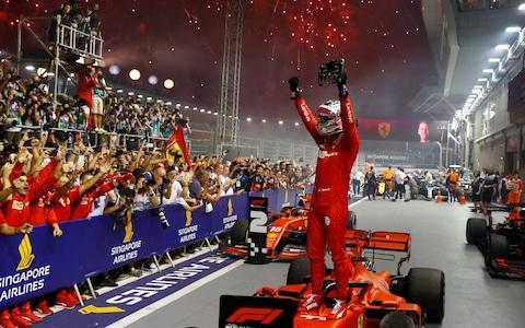 September 22, 2019 Ferrari's Sebastian Vettel celebrates after winning the race - Credit: REUTERS