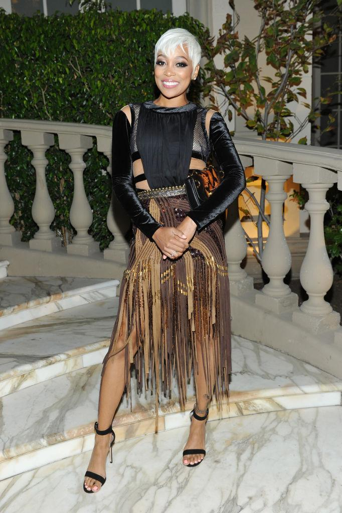 <p>The singer posed in a black and brown fringe dress. (Photo by Donato Sardella/Getty Images for BALMAIN) </p>