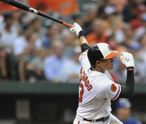 Baltimore Orioles' Manny Machado follows through on a RBI-triple against the Texas Rangers in the third inning of a baseball game on Wednesday, July 10, 2013, in Baltimore. (AP Photo/Gail Burton)