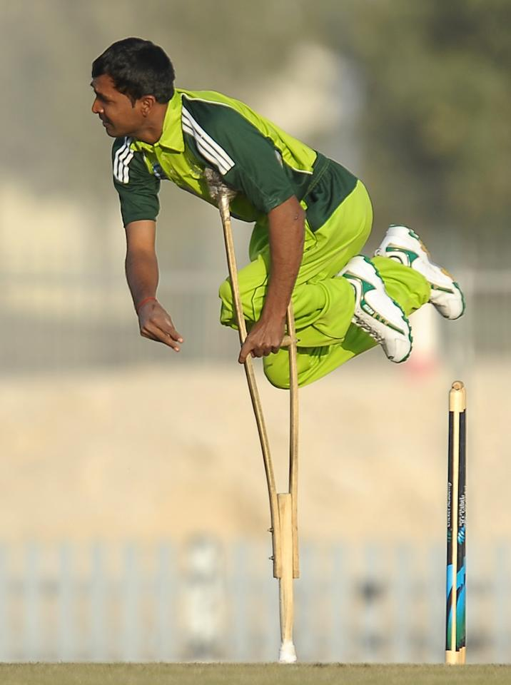 Pakistan disabled cricketer Farhan Saeed delivers the ball during the T20 match between England Disaballity team and Pakistan Disaballity team at the ICC Global Cricket Academy (ICC GCA) in Dubai Sports City on February 11, 2012. Pakistan beat England in the first-ever Twenty20 match between the physically challenged cricket teams by 14 runs. AFP PHOTO/ LAKRUWAN WANNIARACHCHI (Photo credit should read LAKRUWAN WANNIARACHCHI/AFP/Getty Images)