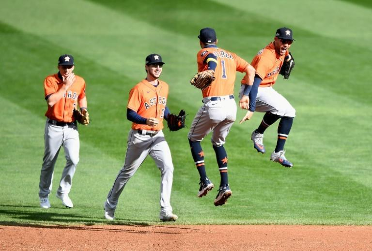 Houston Astros players celebrate after sweeping the Minnesota Twins in the MLB playoffs on Wednesday